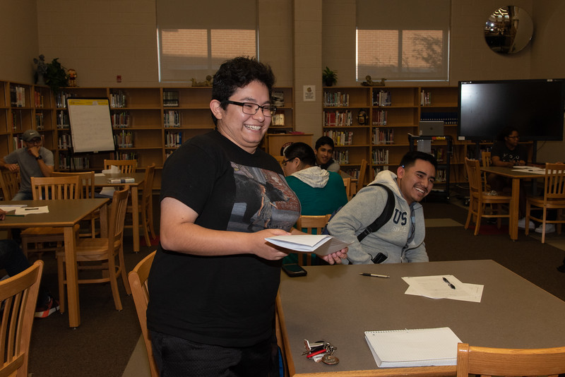 Isabella Ramos (left) with West Oso High School students at the Spanish event at the library.