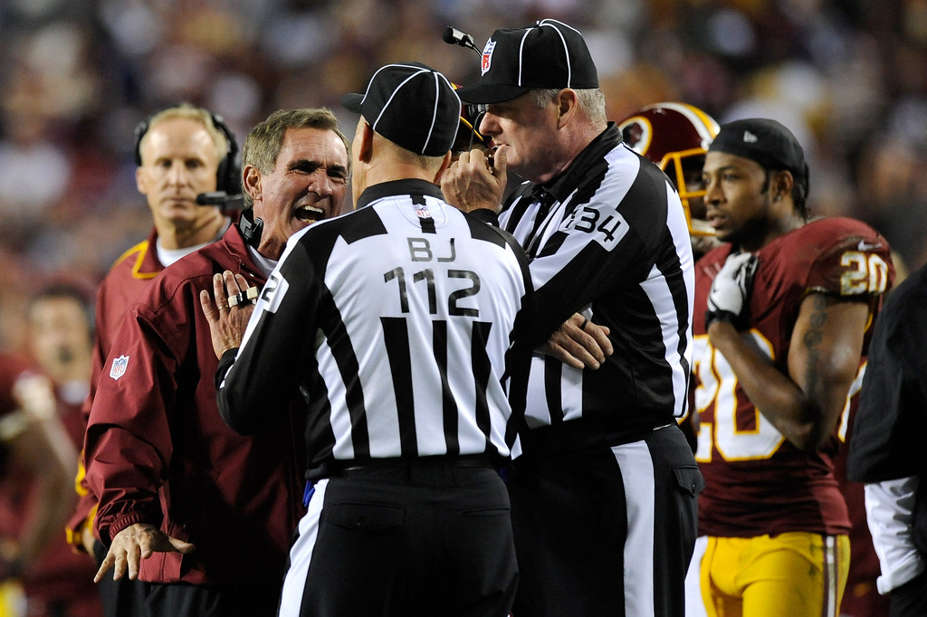 . LANDOVER, MD - DECEMBER 03:  Head coach Mike Shanahan of the Washington Redskins yells at back judge Tony Steratore #112 in the third quarter while taking on the New York Giants at FedExField on December 3, 2012 in Landover, Maryland.  (Photo by Patrick McDermott/Getty Images)