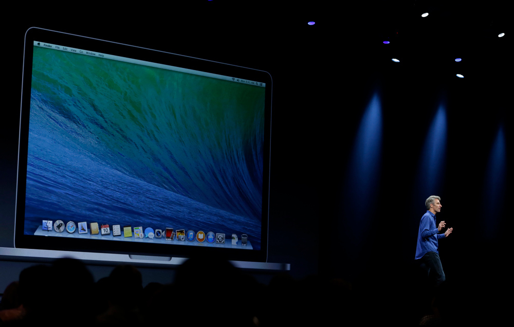 . Craig Federighi, senior vice president of software engineering at Apple, introduces the new OS X Mavericks operating system during the keynote address of the Apple Worldwide Developers Conference, Monday, June 10, 2013, in San Francisco. (AP Photo/Eric Risberg)