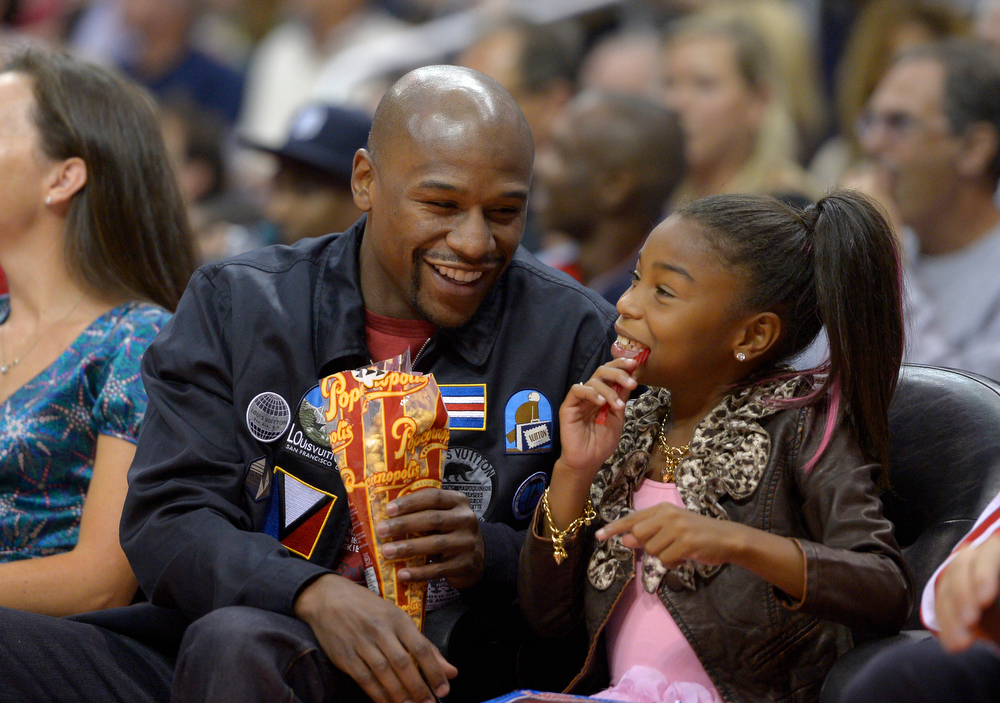 . Floyd Mayweather Jr. and his daughter Ayana watch the Los Angeles Clippers play the San Antonio Spurs in their NBA basketball game, Wednesday, Nov. 7, 2012, in Los Angeles. The Clippers won 106-84.  (AP Photo/Mark J. Terrill)