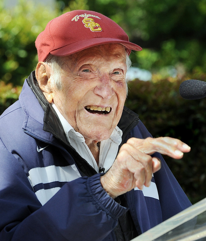 ". Louis Zamperini,  who was a student and track star at USC, asking audience if they knew what hand gesture meant, ""USC Fight On\"", to audience who attended at Tournament of Roses. Zamperini was selected as ]2015 Tournament of Roses Grand Marshal. Olympian and World War II prisoner of war, Louis Zamperini, a true American Hero who survived excessive hardships. (Photo by Walt Mancini/Pasadena Star-News)"