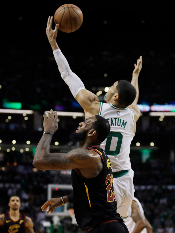 . Boston Celtics forward Jayson Tatum (0) steals a pass intended for Cleveland Cavaliers forward LeBron James (23) during the first quarter of Game 5 of the NBA basketball Eastern Conference Finals, Wednesday, May 23, 2018, in Boston. (AP Photo/Charles Krupa)
