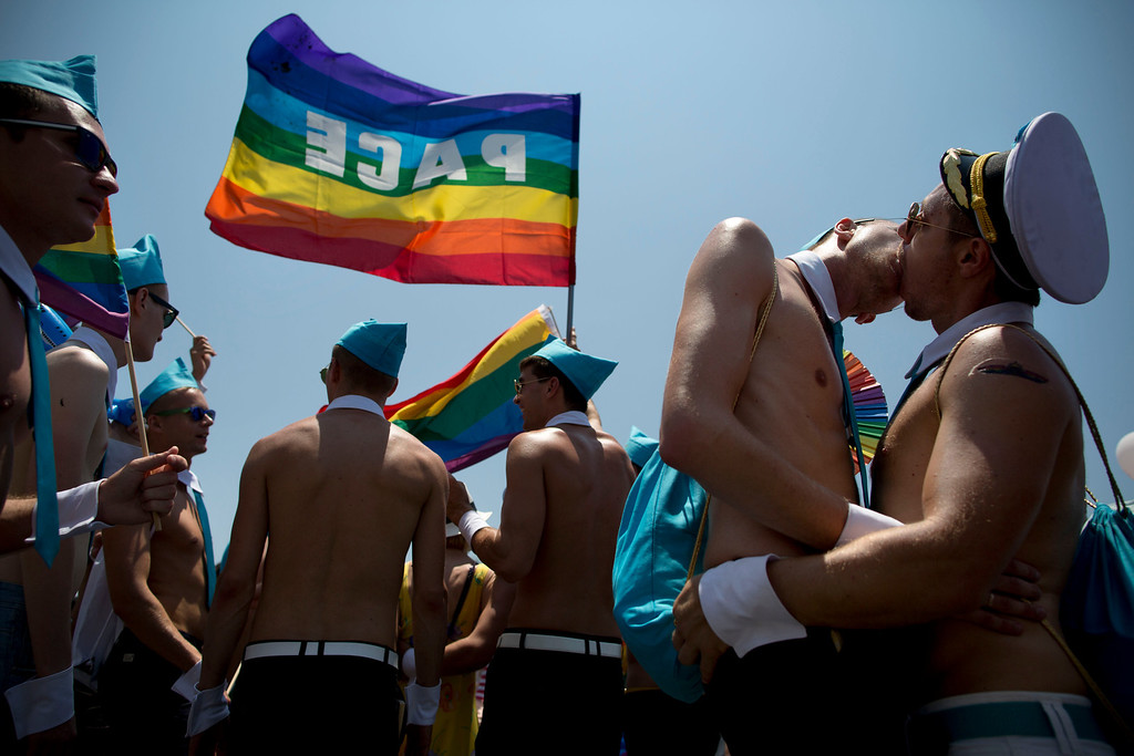. Israeli dancers kiss each other during the annual Gay Pride Parade on a street of Tel Aviv, Israel, Friday, June 13, 2014.  (AP Photo/Oded Balilty)