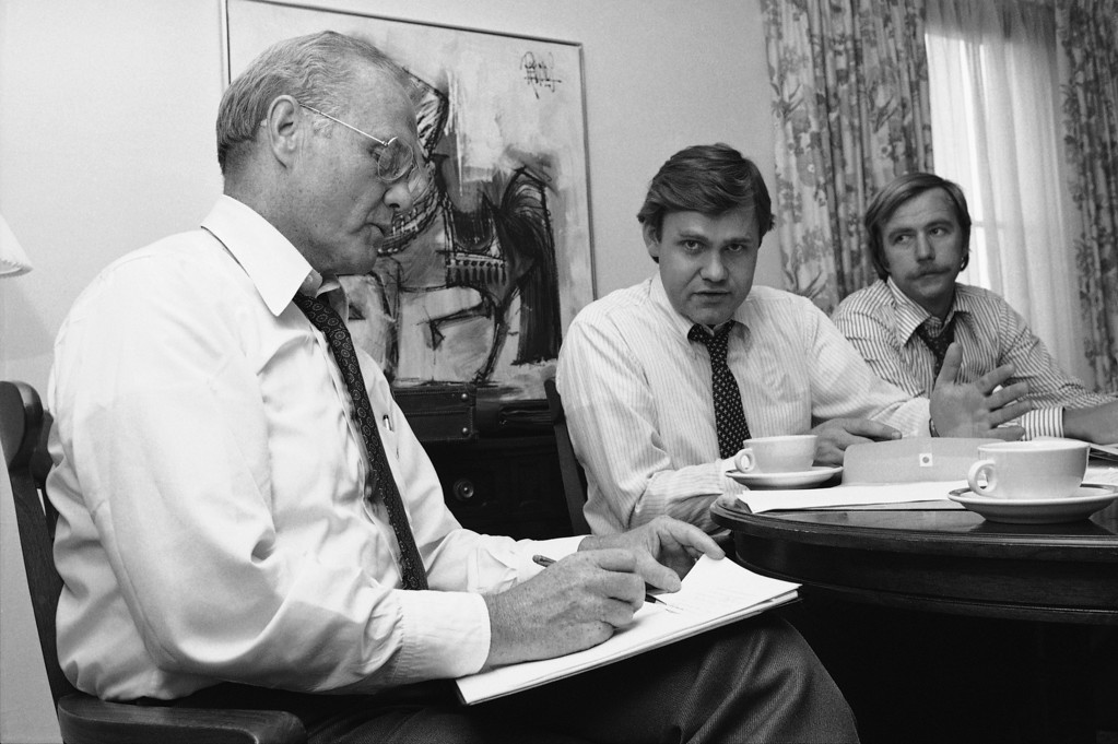 . Sen. John Glenn of Ohio, left, checks with an unidentified assistant as he prepares his keynote speech at a hotel, Sunday, July 12, 1976, New York. Glenn, the first American to orbit the earth when he was an astronaut, is among seven potential running mates for Jimmy Carter who is expected to be the Democratic presidential candidate in 1976. (AP Photo/Ron Frehm)