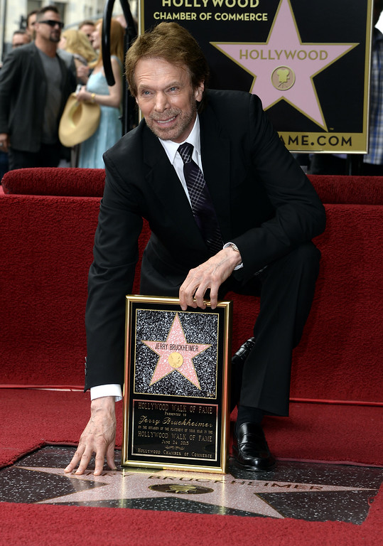 . US producer Jerry Bruckheimer touches his star during a ceremony honoring him on the Hollywood Walk of Fame, in Hollywood, California, USA, 24 June 2013. Bruckheimer received the 2,501st star on the Hollywood Walk of Fame.  EPA/MICHAEL NELSON