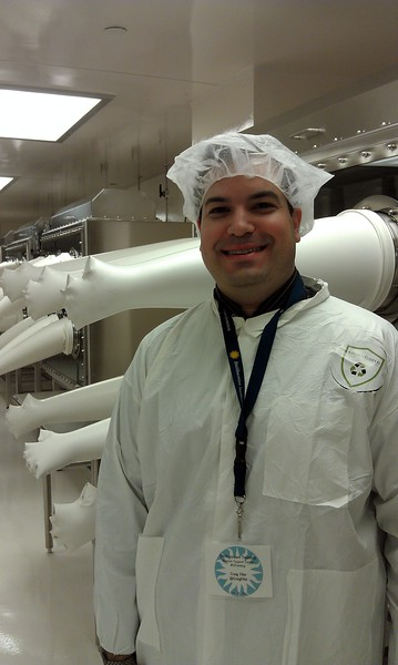 Craig models cleanroom protective clothing while viewing the National Meteorite Collection