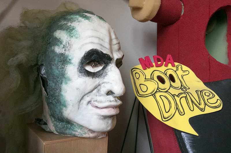 Fitchburg Firefighter Yona Vaughan is surround by the costumes he makes and his four self published books at his home in Leominster Friday, September 6, 2019. This mask he made is of Beetlejuice from the movie of the same name. SENTINEL & ENTERPRISE/JOHN LOVE