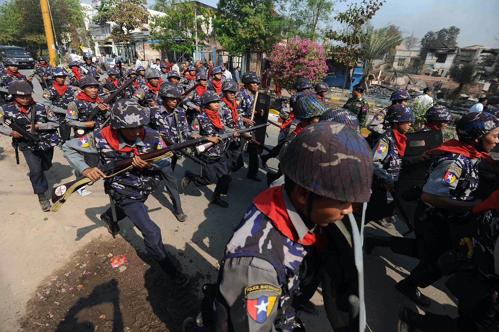 . Policemen deploy in riot-hit Meiktila, central Myanmar on March 22, 2013.    AFP PHOTO/ Soe Than WIN/AFP/Getty Images