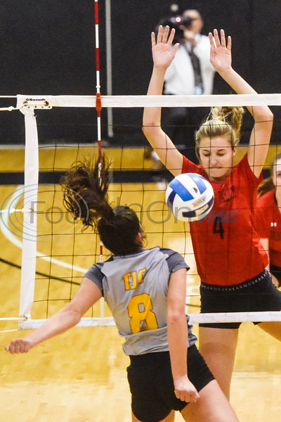 Tyler Junior College's Breeana Gamueda (8) hit is blocked by Trinity Valley Community College's Erica Airheart (4) during a college volleyball game at Tyler Junior College in Tyler, Texas, on Wednesday, Sept. 19, 2018. (Chelsea Purgahn/Tyler Morning Telegraph)