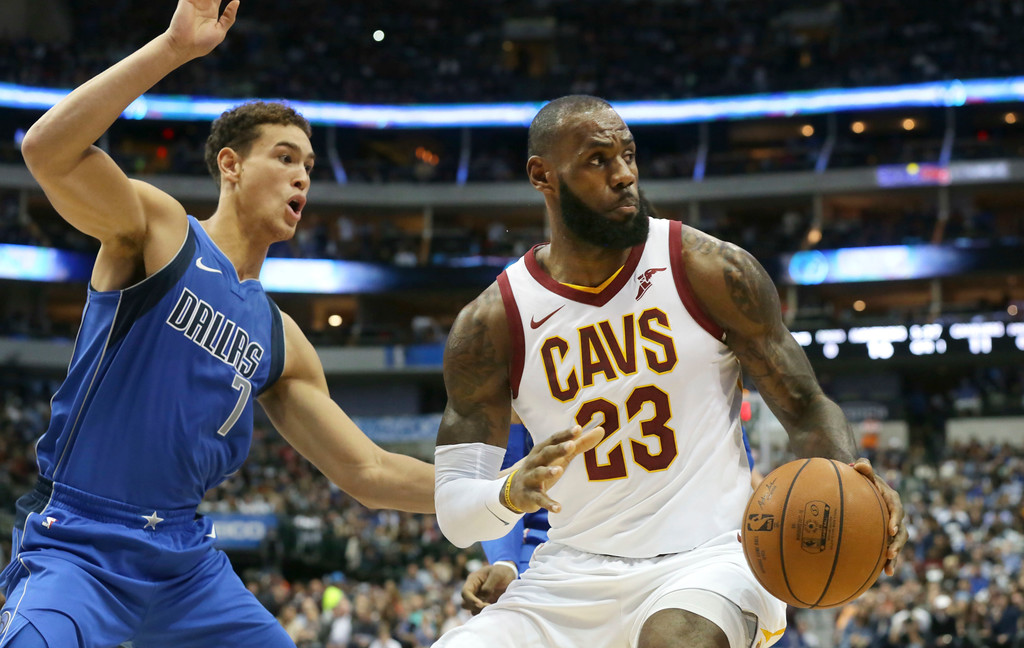 . Cleveland Cavaliers forward LeBron James (23) is defended by Dallas Mavericks forward Dwight Powell (7) during the first half of an NBA basketball game in Dallas, Saturday, Nov. 11, 2017. (AP Photo/LM Otero)