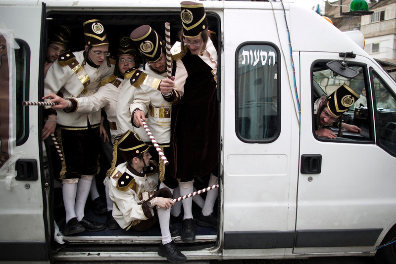 . Ultra Orthodox Jewish men celebrate the Jewish Holiday of Purim in the Mea Shaarim neighborhood in Jerusalem, Israel, 17 March 2014. The Jewish holiday of Purim celebrates the Jews\' salvation from genocide in ancient Persia, as recounted in the Scroll of Esther.  (EPA/ABIR SULTAN)