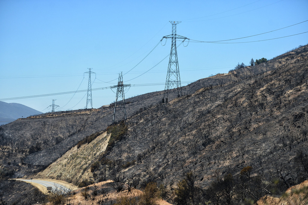 . Power poles in the burned out Powerhouse fire area along San Francisquito Canyon Road in Green Valley. (Hans Gutknecht/Los Angeles Daily News)