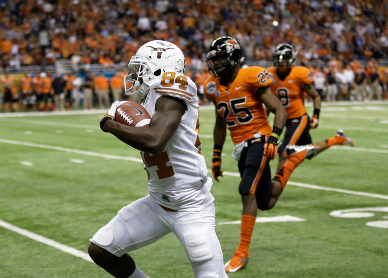 . Texas\' Marquise Goodwin (84) runs for a 64-yard touchdown during the second quarter of the Alamo Bowl NCAA football game against Oregon State, Saturday, Dec. 29, 2012, in San Antonio.  (AP Photo/Eric Gay)