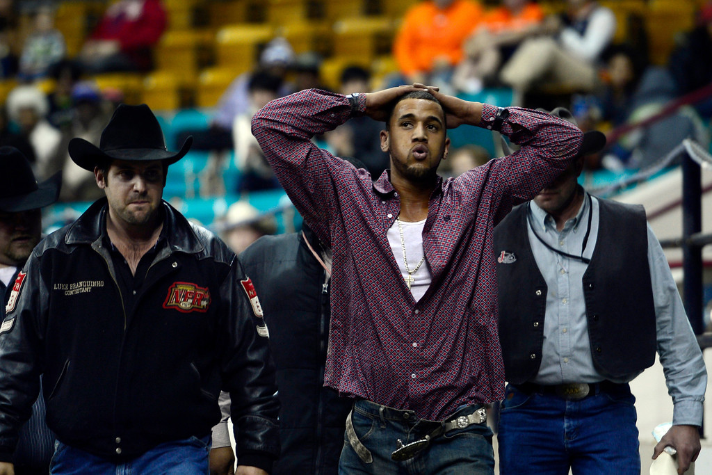 . DENVER, CO. - JANUARY 21:  Chase Crane takes a breath after colliding with the fence while dismounting his horse during the steer wrestling performance at the National Western Stock Show Martin Luther King Heritage Rodeo January 21, 2013 (Photo By AAron Ontiveroz / The Denver Post)