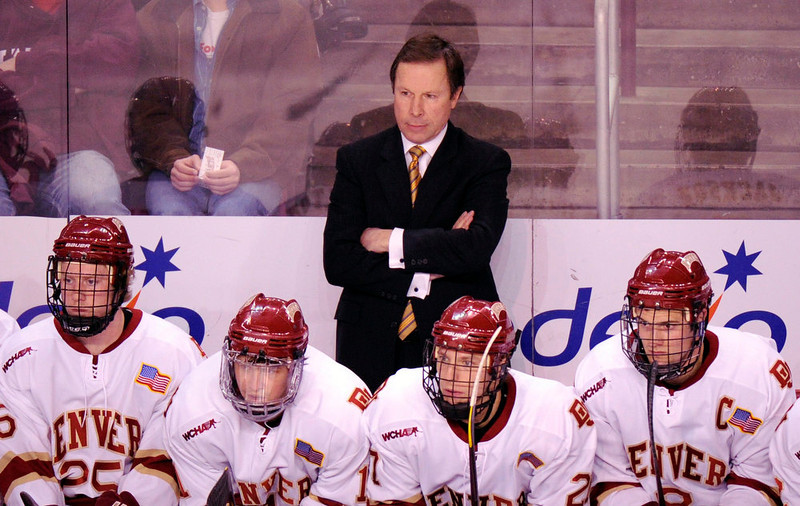 . University of Denver head coach George Gwozdecky, top, is in the game against Union College during the 1st period of the game at Magness Arena in Denver, Colorado, Friday, December 30, 2011. Hyoung Chang, The Denver Post