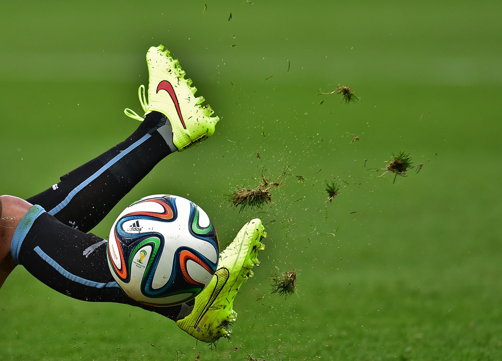 . A Uruguayan player kicks the ball during the Group D football match between Uruguay and England at the Corinthians Arena in Sao Paulo on June 19, 2014, during the 2014 FIFA World Cup. (NELSON ALMEIDA/AFP/Getty Images)
