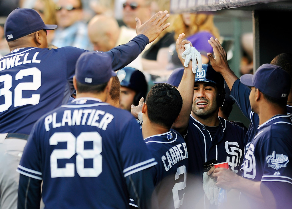. San Diego Padres Carlos Quentin is congratulated by his teammates after scoring in the fourth inning of a baseball game against the Colorado Rockies on Thursday, June 6, 2013 in Denver. The Padres won 6-5. (AP Photo/Chris Schneider)