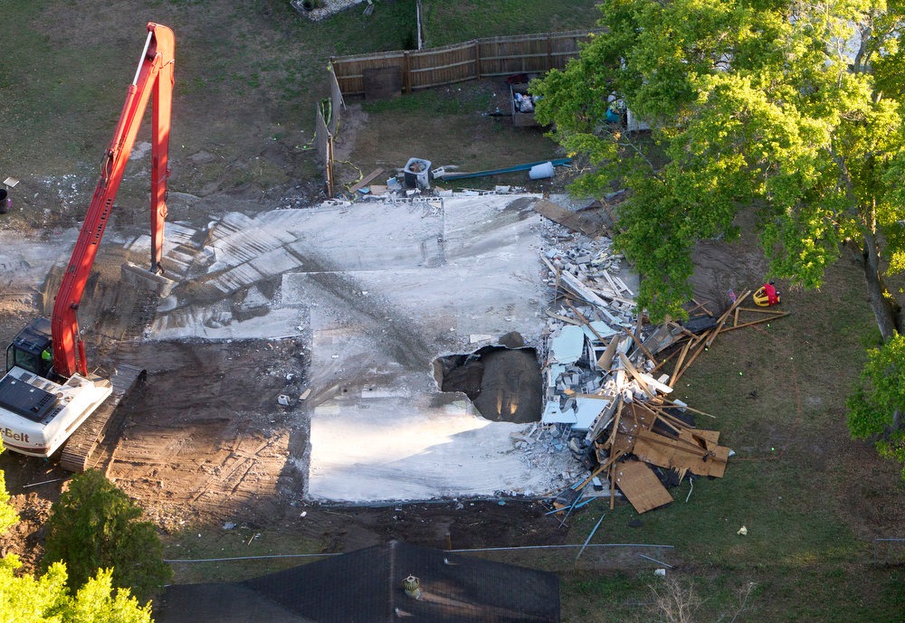 . A huge sinkhole opened up under a bedroom in the home of Jeff Bush last Thursday, Feb. 28,  and swallowed  Jeff Bush, 37. Officials gave up hope of finding Bush alive and filled in the hole with crushed rock.  (AP Photo/The Tampa Bay Times, Dirk Shadd)