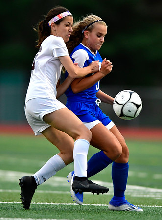 9/12/2019 Mike Orazzi | StaffrFarmington's Sydney Caccamo (16) and Bristol Eastern's Breanna Venturo-Nelson (3) during girls soccer under the lights on Thursday at Eastern. r