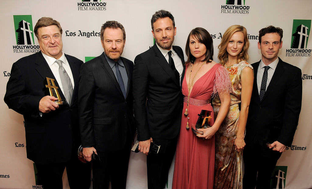 """. \""""Argo\"""" cast members, from left, John Goodman, Bryan Cranston, Ben Affleck, Clea DuVall, Kerry Bishe\' and Scoot McNairy, recipients of the Hollywood Ensemble Acting Award, pose together backstage at the 16th Annual Hollywood Film Awards Gala on Monday, Oct. 22, 2012, in Beverly Hills, Calif. (Photo by Chris Pizzello/Invision/AP)"""