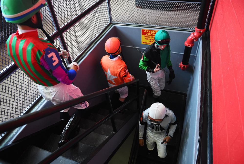 . Jockeys walk down stairs prior to the 139th running of the Preakness Stakes at Pimlico Race Course on May 17, 2014 in Baltimore, Maryland.  (Photo by Patrick Smith/Getty Images)