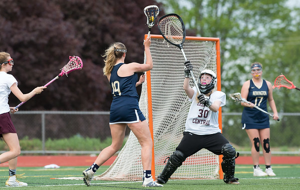 05/10/19 Wesley Bunnell | Staff Newington girls lacrosse defeated Bristol Central in an away game at Bristol Central High School on Friday afternoon. Newington's Maya Yajaviah (19)