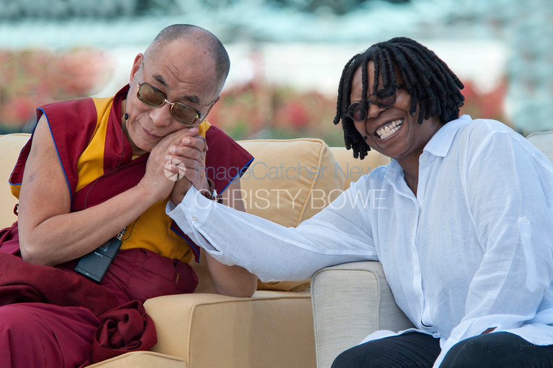 His Holiness The Dalai Lama  shares a moment with Whoopi Goldberg on the west lawn of the Capitol as he speaks about of world peace.