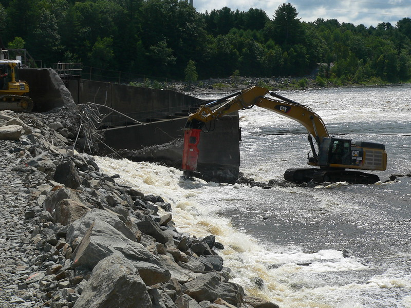 NPK GH23 hydraulic hammer on CAT excavator Maine Dam Demolition (23).JPG