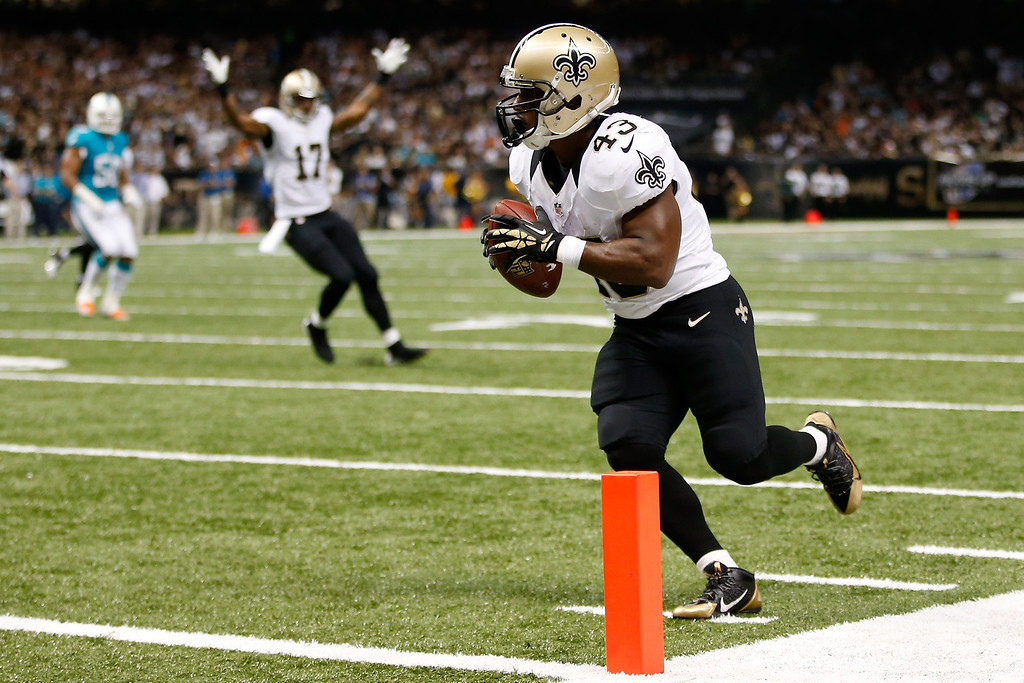 . Running back Darren Sproles #43 of the New Orleans Saints scores on a 13-yard touchdown catch in the second quarter against the Miami Dolphins at the Mercedes-Benz Superdome on September 30, 2013 in New Orleans, Louisiana.  (Photo by Chris Graythen/Getty Images)