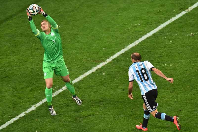 . Argentina\'s forward Rodrigo Palacio (R) makes a failed attempt at goal as Netherlands\' goalkeeper Jasper Cillessen (L) catches the ball during extra time of the semi-final football match between Netherlands and Argentina of the FIFA World Cup at The Corinthians Arena in Sao Paulo on July 9, 2014. (GABRIEL BOUYS/AFP/Getty Images)
