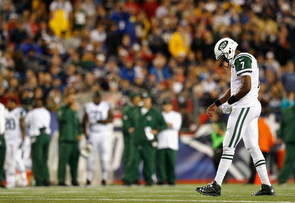 . Geno Smith #7 of the New York Jets reacts during the first quarter against the New England Patriots at Gillette Stadium on October 16, 2014 in Foxboro, Massachusetts.  (Photo by Jim Rogash/Getty Images)