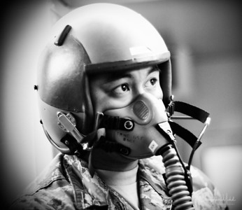 Airman monitors Christopher Michel in the pressure chamber.