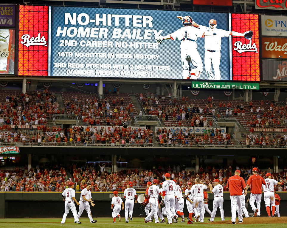 . The Cincinnati Reds celebrate on field after starting pitcher Homer Bailey, second from left, threw a no-hitter against the San Francisco Giants in a baseball game, Tuesday, July 2, 2013, in Cincinnati. Cincinnati won 3-0. (AP Photo/Al Behrman)