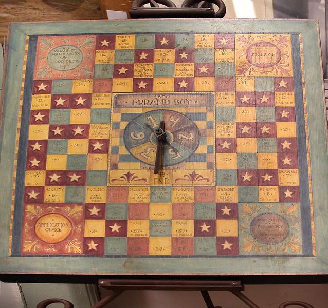rplica of 1800's wood burned board game.jpg