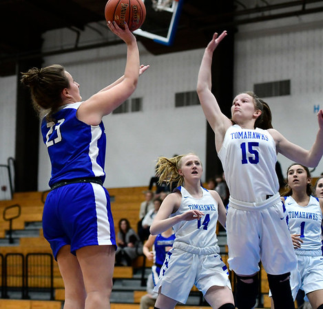 3/5/2020 Mike Orazzi | StaffrSouthington's Megan Mikosz (23)and Glastonbury's Charlotte Bassett (15) during the Class LL Second Round of the CIAC 2020 State Girls Basketball Tournament at Glastonbury High School on Thursday night.