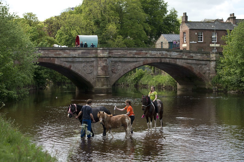 . People wash horses in the River Eden on the opening day of the annual Appleby Horse Fair, in the town of Appleby-in-Westmorland, North West England on June 4, 2015. The annual event attracts thousands of travelers from across Britain to gather and buy and sell horses. AFP PHOTO / OLI SCARFF/AFP/Getty Images