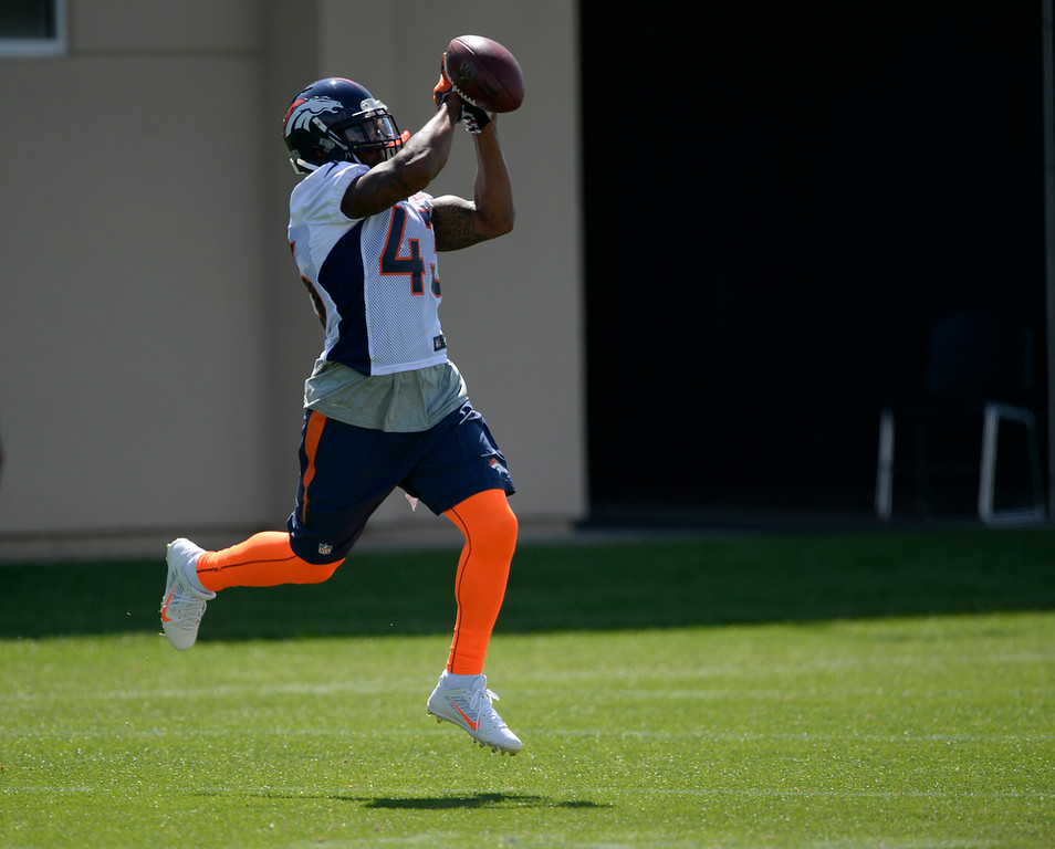 . Denver Broncos strong safety T.J. Ward (43) catches a pass during practice August 25, 2014 at Dove Valley.(Photo by John Leyba/The Denver Post)