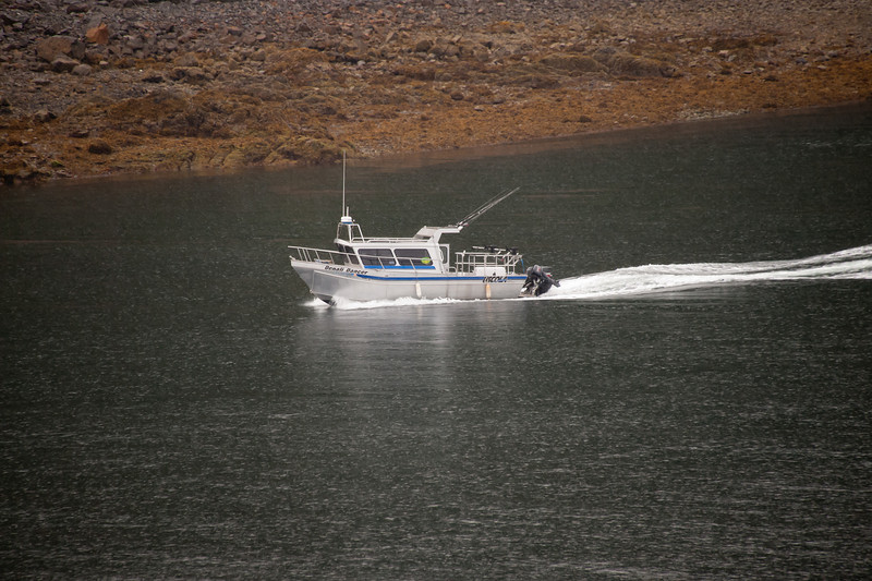 A fishing boat heads out.