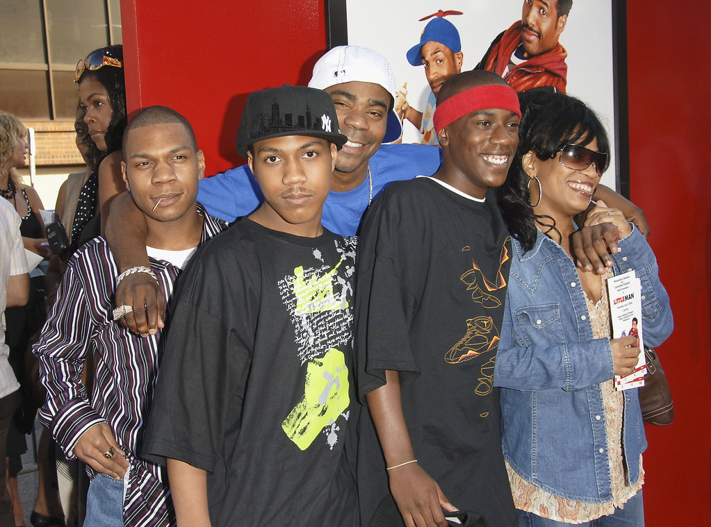 """. Actor Tracy Morgan (in rear wearing white hat) and his family attend Sony Pictures premiere of \""""Little Man\"""" at the Mann National Theater on July 6, 2006 in Westwood, California.  (Photo by Stephen Shugerman/Getty Images)"""