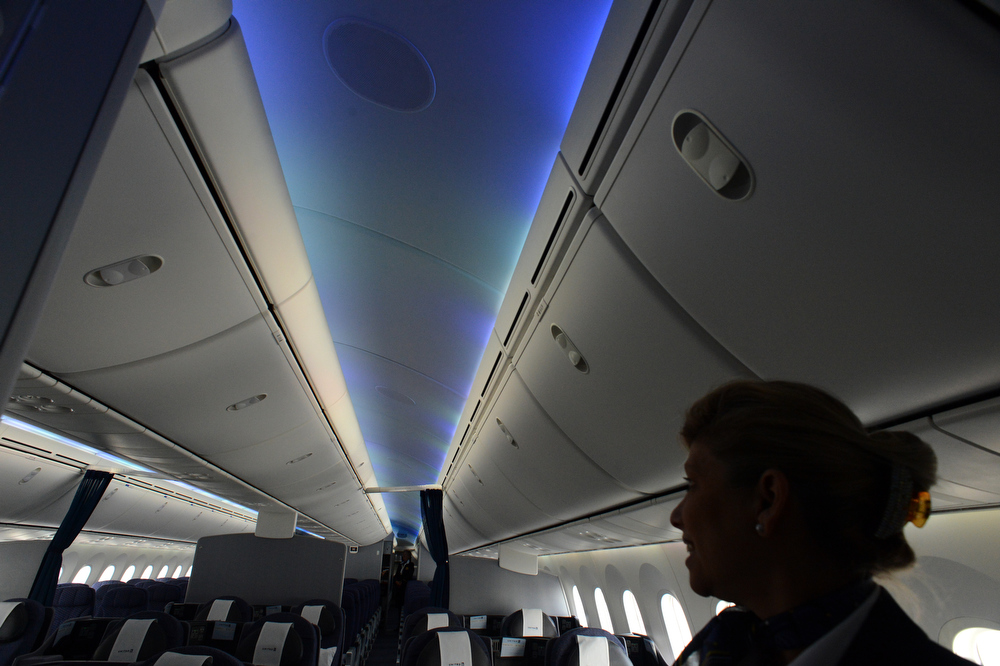 . United Airline Inflight Supervisor Cheryl Carney talks about the LED cabin lighting and the stowage bins while touring the 787 Dreamliner at Denver International Airport on Thursday, Nov. 29, 2012. By March, the new jet is scheduled to begin flying between Denver International Airport and Japan\'s Narita International Airport. Craig F. Walker, The Denver Post