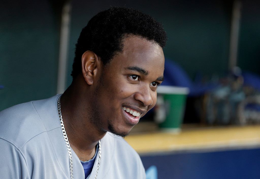 . Kansas City Royals pitcher Yordano Ventura smiles in the dugout against the Detroit Tigers in the fifth inning of a baseball game in Detroit, Tuesday, June 17, 2014.  (AP Photo/Paul Sancya)