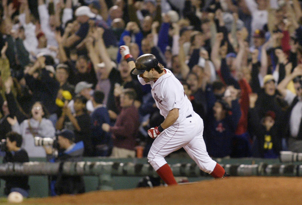 . TODD WALKER -- Boston Red batter Todd Walker pumps his fist as he rounds first after he connected for a three-run home run in the ninth inning to tie a game against the Baltimore Orioles at Fenway Park in Boston, on Sept. 23 2003.   (AP Photo/Jim Rogash)