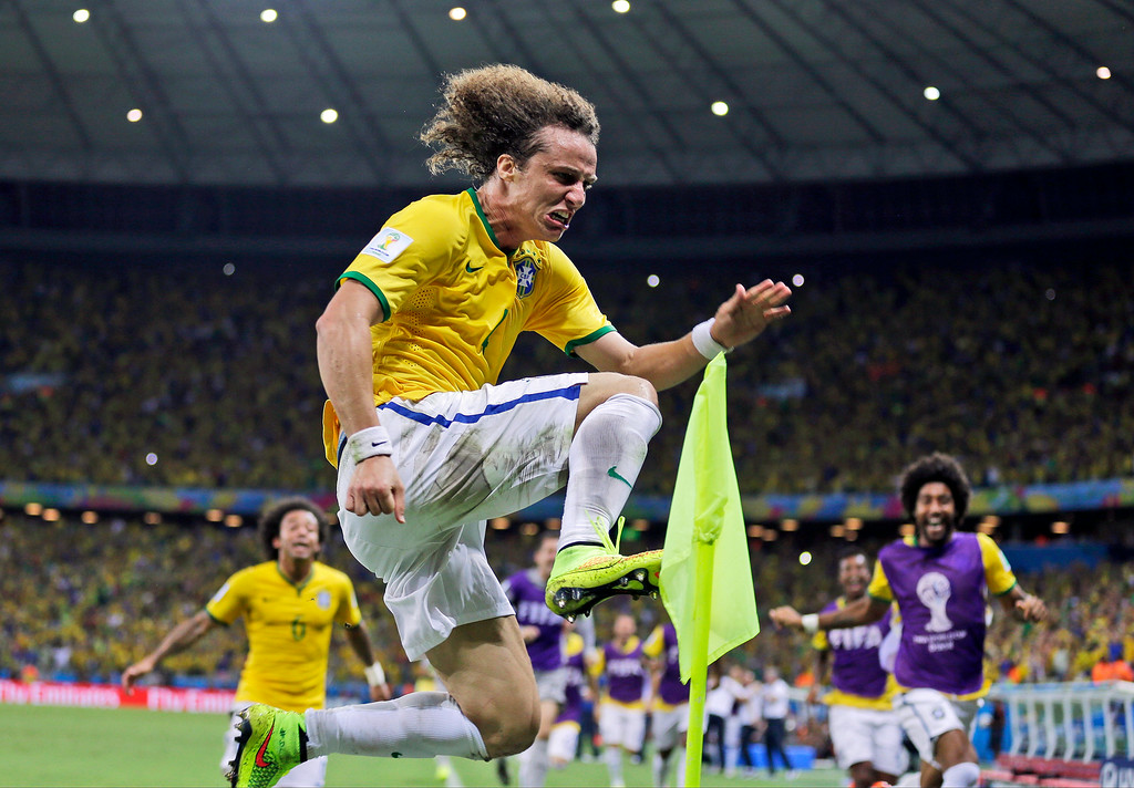 . Brazil\'s David Luiz celebrates after scoring his side\'s second goal on a free kick during the World Cup quarterfinal soccer match between Brazil and Colombia at the Arena Castelao in Fortaleza, Brazil, Friday, July 4, 2014. (AP Photo/Natacha Pisarenko)