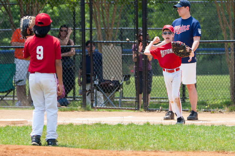 Sam fields the ball near 1st base and hustles back for the out in the bottom of the 3rd inning. The bats of the Nationals were supported by a great defensive outing in a 11-4 win over the Twins. They are now 7-3 for the season. 2012 Arlington Little League Baseball, Majors Division. Nationals vs Twins (13 May 2012) (Image taken by Patrick R. Kane on 13 May 2012 with Canon EOS-1D Mark III at ISO 400, f4.0, 1/1600 sec and 170mm)