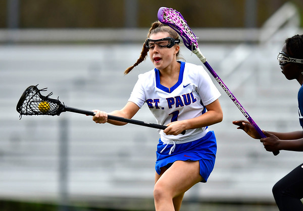 5/2/2019 Mike Orazzi | Staff St. Paul's Emma Cretella (1)) during Thursday's girls lacrosse with Amistad in Bristol.