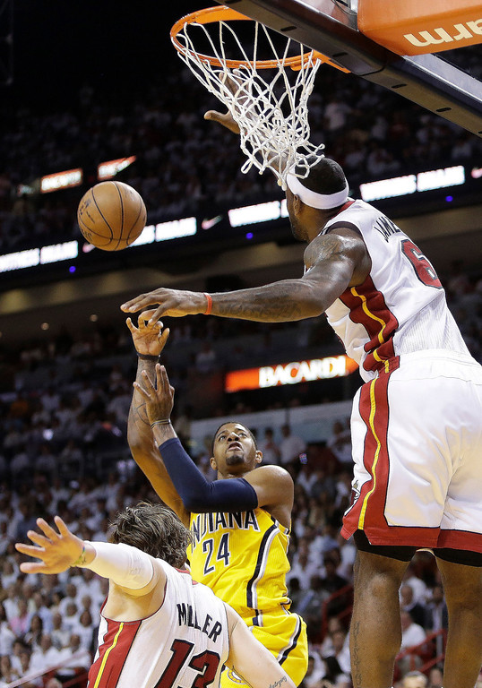 . Miami Heat small forward LeBron James (6) blocks a shot to the basket by Indiana Pacers small forward Paul George (24) as Miami Heat shooting guard Mike Miller (13) falls to the court during the first half of Game 7 in their NBA basketball Eastern Conference finals playoff series, Monday, June 3, 2013 in Miami. (AP Photo/Lynne Sladky)