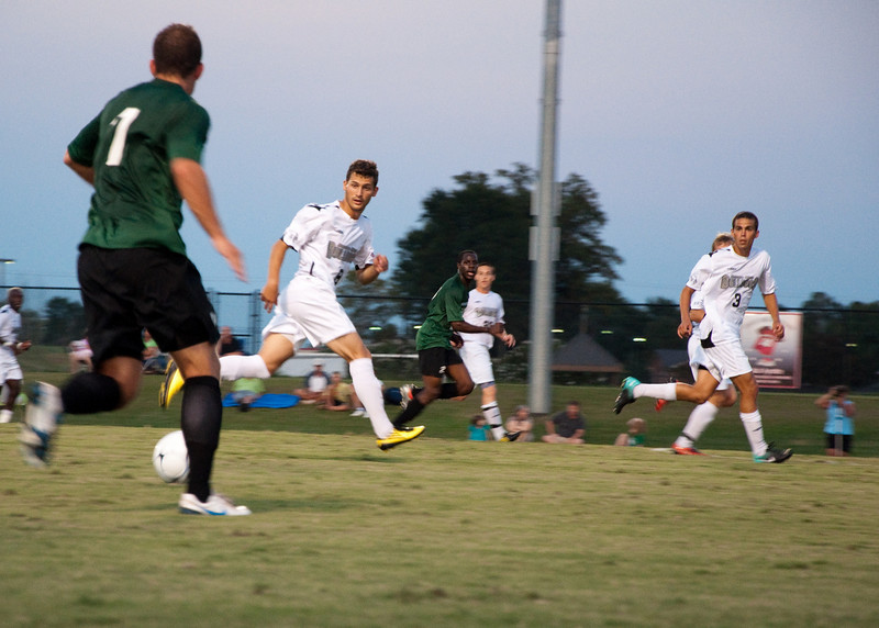 GWU midfielder Adam Augurso (8) and defender Ian Hartfield (3) cut off an attack by USC-Upstate.