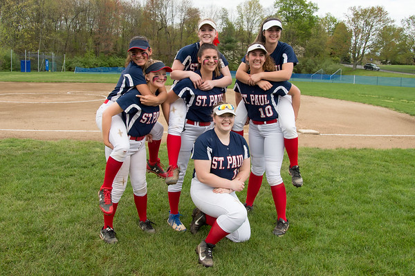05/6/19 Wesley Bunnell | Staff St. Paul Seniors are all smiles before he start of their game on Monday afternoon on Senior Day. McKenzie Gauthier, (3) and Hannah Orzell (13), L, Abby Poirot and Julia Sosnowski (33), Jessica Persechino (30) and Rebecca Nerbonne (10) and Carolyn Marchak (19), kneeling.