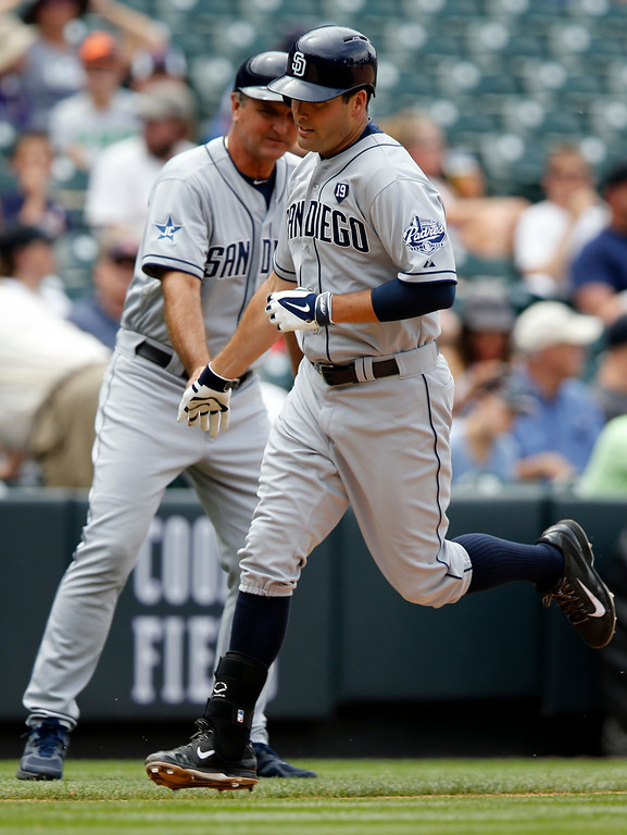 . San Diego Padres\' Seth Smith rounds the bases after hitting a solo home run off Colorado Rockies starting pitcher Jair Jurrjens during the fifth inning of a baseball game on Wednesday, July 9, 2014, in Denver. (AP Photo/Jack Dempsey)