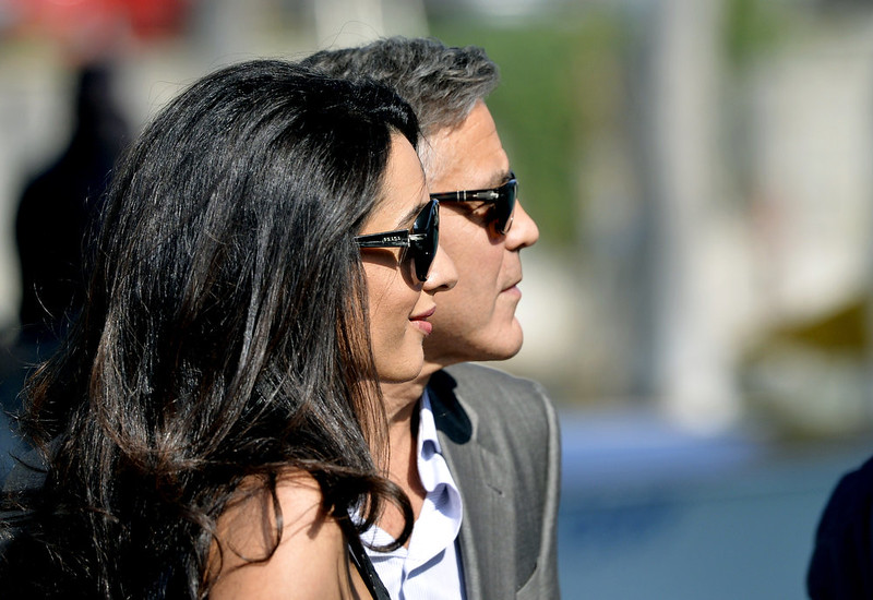 . US actor George Clooney (R) and his Lebanon-born British fiancee Amal Alamuddin take a taxiboat upon their arrival in Venice on September 26, 2014, on the eve of their wedding. The party of the year is happening here: the fresco-adorned Aman hotel on Venice\'s Grand Canal is feverishly preparing for George Clooney\'s wedding to Amal Alamuddin, his Lebanon-born British fiancee. Hollywood stars and the world\'s paparazzi have already begun arriving for the nuptials of the world\'s most sought-after catch, who will, sources said, celebrate with 136 guests at the exclusive seven-star hotel in the 450-year-old Palazzo Papadopoli. ANDREAS SOLARO/AFP/Getty Images